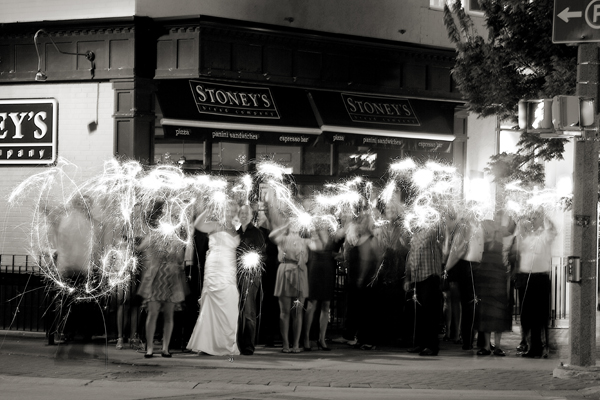 Wedding party outside Stoney's Bread Company with sparklers