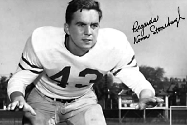 Portrait of Norm Stoneburgh in a football jersey